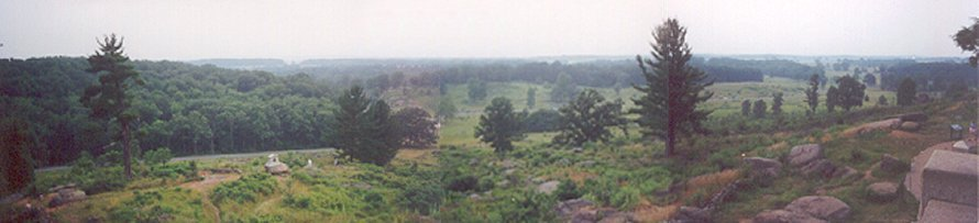 View from Little Roundtop.  Gettysburg is to the far right about two miles away.  Cemetery Ridge is visible right of the center of the image.  The boulders of Devil's Den are just to the left of center.  Big Roundtop is to the left.