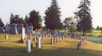 Two Confederate graves are in the foreground, behind them are the Unoin soldiers graves.  The National Cemetery holds the majority of Union men buried in the area.